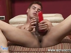 Lovely boy satisfying his anal cravings with a butt toy