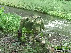 Brown soldier strips naked by the stream