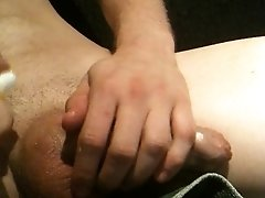 rubbing the wet oily cock
