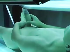 Tanning booth wank