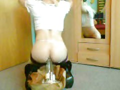 cute Sissy in stockings rides a huge Bottle